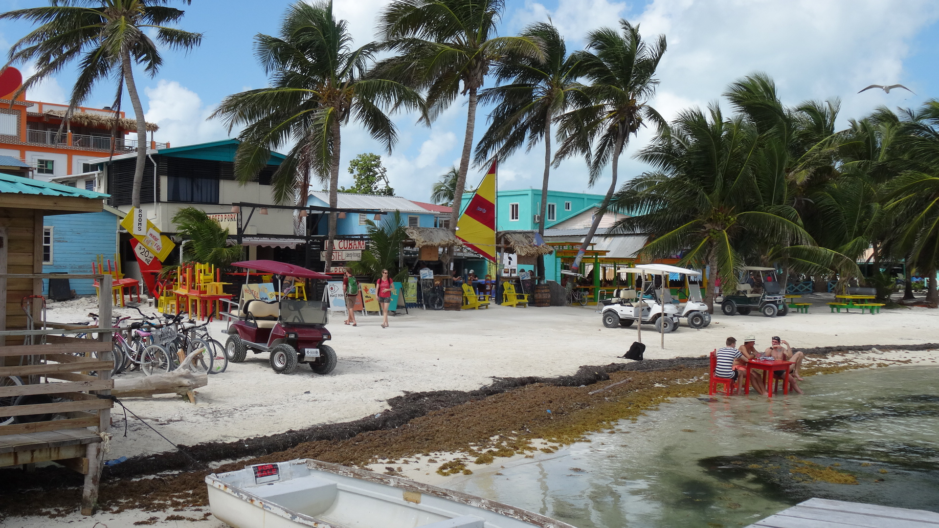 Caye Caulker Bright Buildings And Golf Buggies
