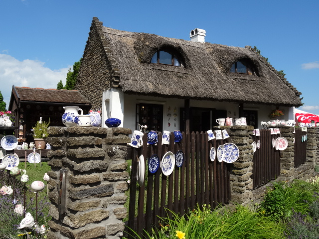 Thatched Roofs, Hand Embroidered Table Cloths and Hand Painted Crockery In Tihany